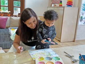 Parent & child creating art.