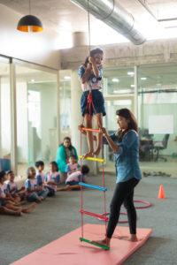Child climbing a ladder