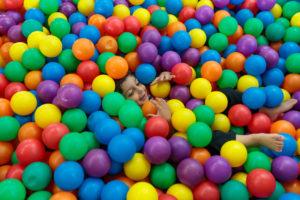 Child inside ball pool