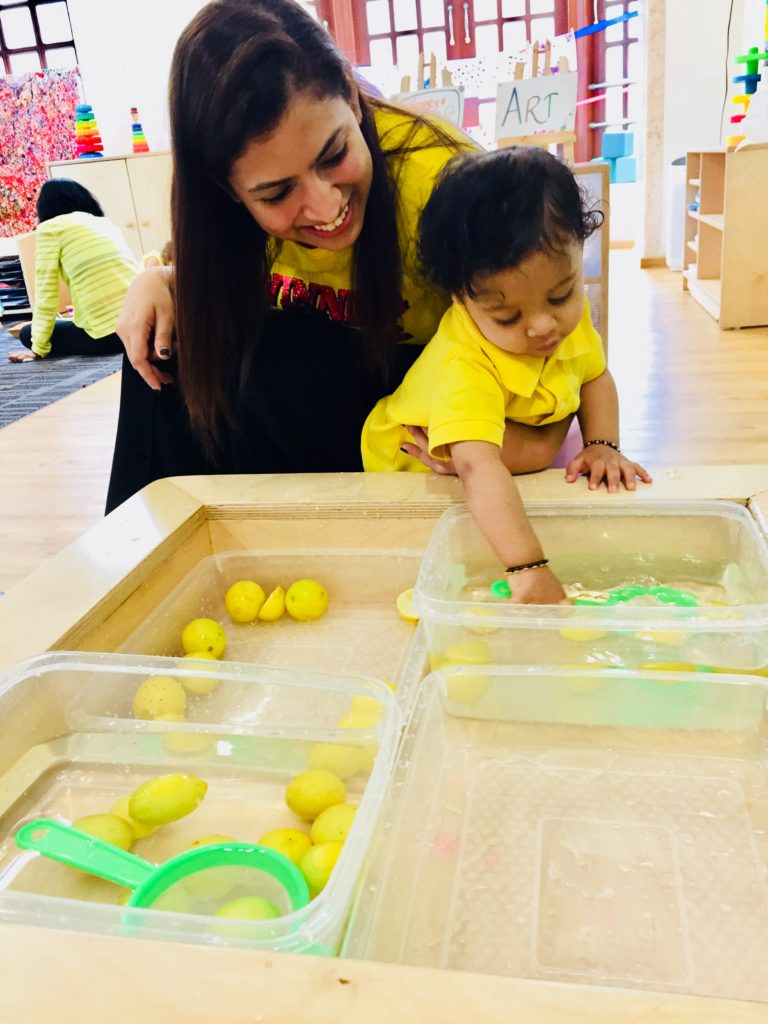 Scoop the lemons activity in the parent toddler classroom